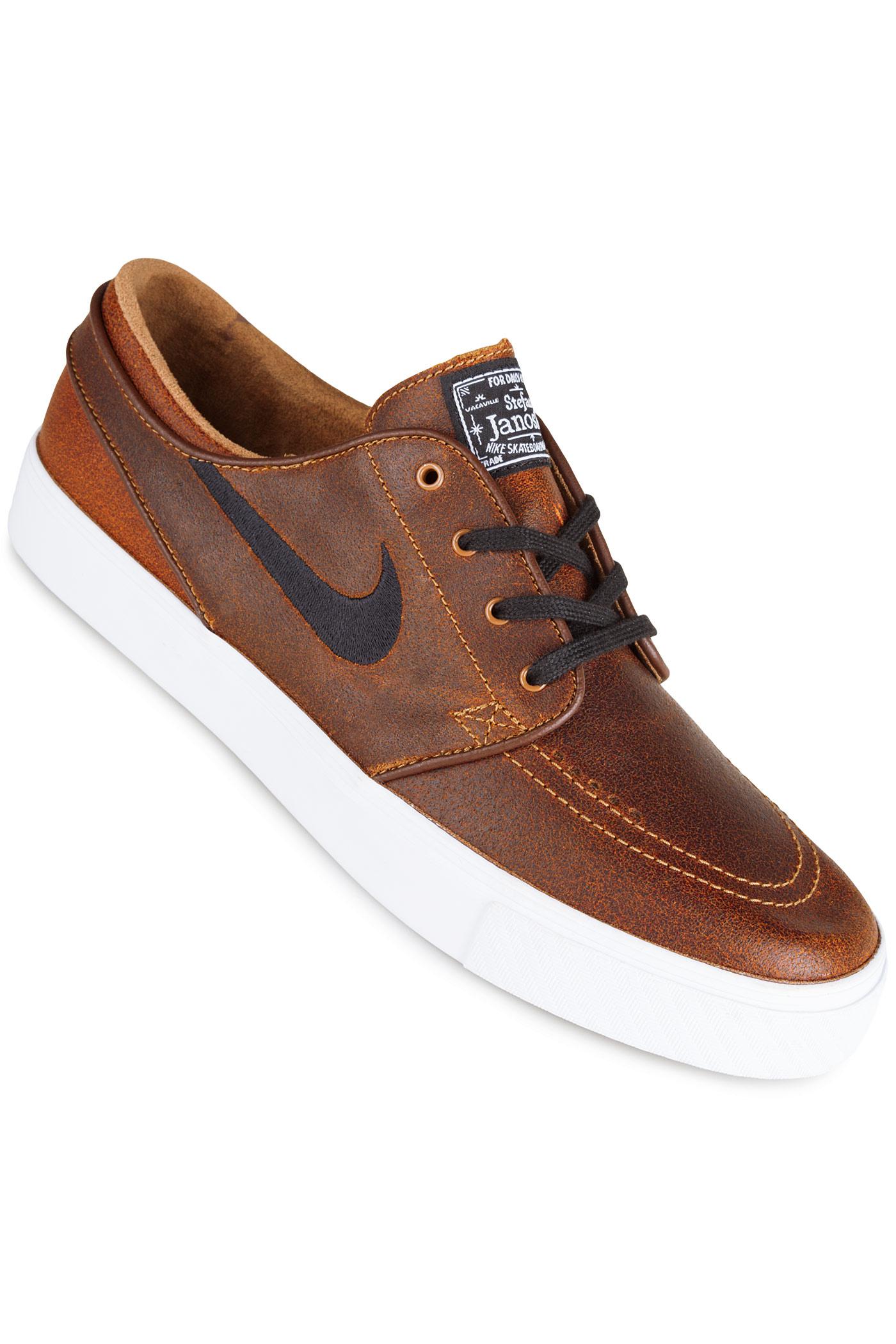 new product 7dbed 632e9 Nike SB Zoom Stefan Janoski Elite Shoes (ale brown black)